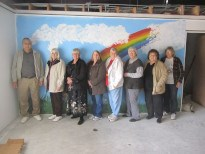 People in front of rainbow wall